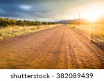 country dirt road heading in... | Shutterstock . vector #382089439