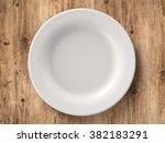 top view empty dish on wooden... | Shutterstock . vector #382183291
