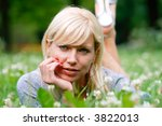 the young girl lays in a grass | Shutterstock . vector #3822013
