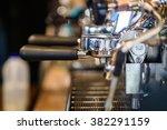 prepares coffee in his coffee... | Shutterstock . vector #382291159