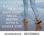 woman walking along a beach... | Shutterstock . vector #382308841