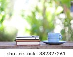 blue vintage cup and notebooks... | Shutterstock . vector #382327261