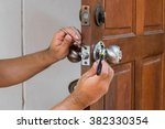 wood door and locksmith... | Shutterstock . vector #382330354