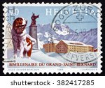 Small photo of SWITZERLAND - CIRCA 1989: a stamp printed in Switzerland shows St. Bernard Dog, Statue of Saint and Hospice on Summit, Great St. Bernard Pass Bimillennium, circa 1989