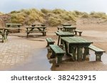 Photo Of Benches And Sand Dune...