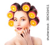 pretty girl with slices of... | Shutterstock . vector #382426411