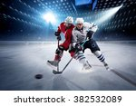 hockey players shoots the puck... | Shutterstock . vector #382532089