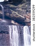 Small photo of Small waterfall caused by snowmelt in the lagoon Pe�±alara Lagoon, National Park Sierra de Guadarrama