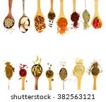 Spices In Spoons Isolated On...