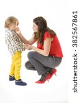 mother consoling her little boy ... | Shutterstock . vector #382567861