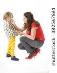 mother consoling her little boy ... | Shutterstock . vector #382567861