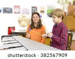 kid studying percussion... | Shutterstock . vector #382567909