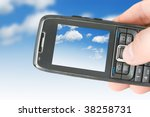 mobile phone and blue sky | Shutterstock . vector #38258731