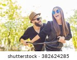 laughing hipster couple hanging ... | Shutterstock . vector #382624285