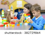 kids and educator playing with... | Shutterstock . vector #382729864