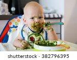 Feeding. Adorable Baby Child...