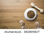 dog food and dog paw on wood... | Shutterstock . vector #382805827