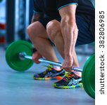bodybuilder with barbell in gym | Shutterstock . vector #382806985