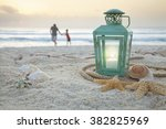Lantern With Shells On Beach...