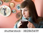 beautiful young woman drinking... | Shutterstock . vector #382865659