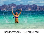 young smiling woman standing in ... | Shutterstock . vector #382883251