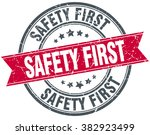 safety first red round grunge... | Shutterstock .eps vector #382923499
