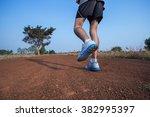 running sport feet on trail... | Shutterstock . vector #382995397