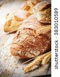 freshly baked bread in rustic... | Shutterstock . vector #383010589