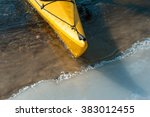 Lonely Yellow Kayak On The...
