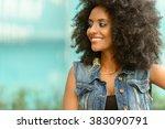 african woman smiling   Shutterstock . vector #383090791