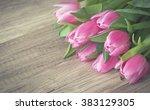 bunch of pink tulips on wooden... | Shutterstock . vector #383129305