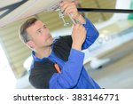 man working on the underside of ... | Shutterstock . vector #383146771