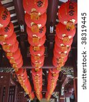 Red lanterns decorating the ceiling of a Chinese Temple in Singapore - stock photo