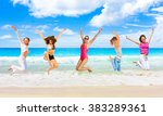 on a beach active girls  | Shutterstock . vector #383289361