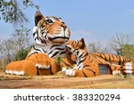 tiger and small tiger in forest | Shutterstock . vector #383320294