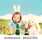 toddler girl collecting easter... | Shutterstock . vector #383337301