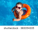Little Girl Swimming In The...