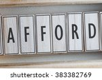 Small photo of AFFORD word on wood blocks concept