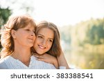 mature mother hugging with her... | Shutterstock . vector #383388541