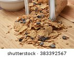 bran and raisin cereal spilling ... | Shutterstock . vector #383392567