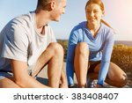 couple of runners lace their... | Shutterstock . vector #383408407