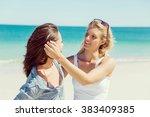 woman friends on the beach | Shutterstock . vector #383409385