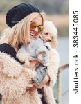Small photo of young caucasian cute girl portrait with dog outdoor in park walking happy and smile all the way