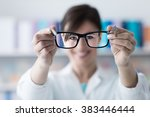 optometrist giving eyewear to... | Shutterstock . vector #383446444