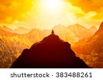 Stock photo woman meditating in sitting yoga position on the top of a mountains above clouds at sunset zen 383488261