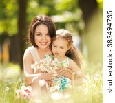mother and daughter in the park | Shutterstock . vector #383494735