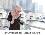 smiling girl in hijab covering...   Shutterstock . vector #383548795