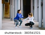 two fitness women doing squat... | Shutterstock . vector #383561521