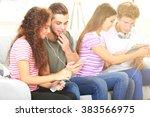 two teenager couples listening... | Shutterstock . vector #383566975