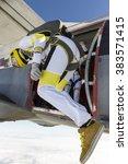 the girl parachutist jumps out... | Shutterstock . vector #383571415